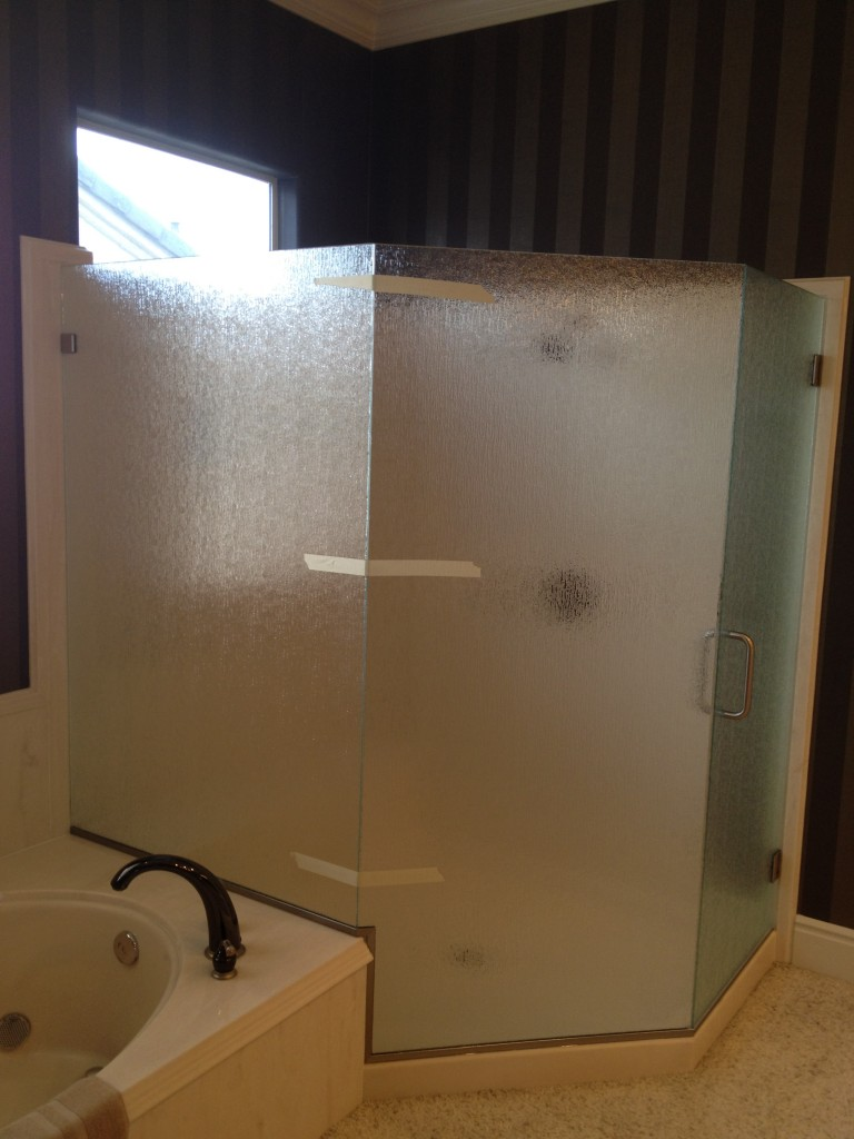 "Frameless shower enclosure in 3/8"" rain glass."
